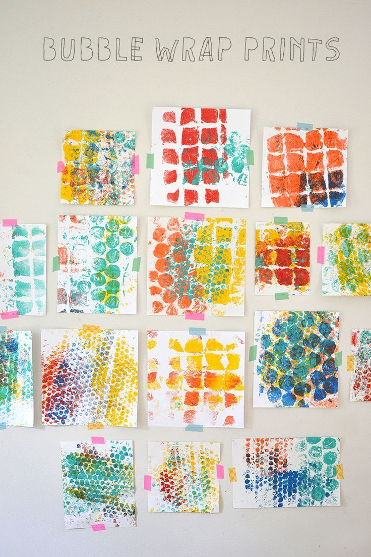 Children explore color and shape while making prints with bubble wrap.
