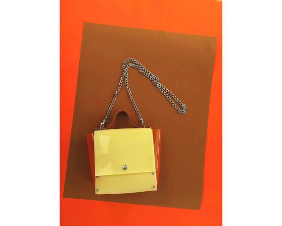 Handbag in vanilla color with leather caramel strap and transparent orange sides, simple minimalism bag, PVC purse fragranced with vanilla  Dimensions: 20 x 20 x 7 cm // 7,87 x 7,87 x 2,76  chain 110 cm/ 43 inches  Made of thick, flexible PVC. A medium handbag city, type of messenger bag/