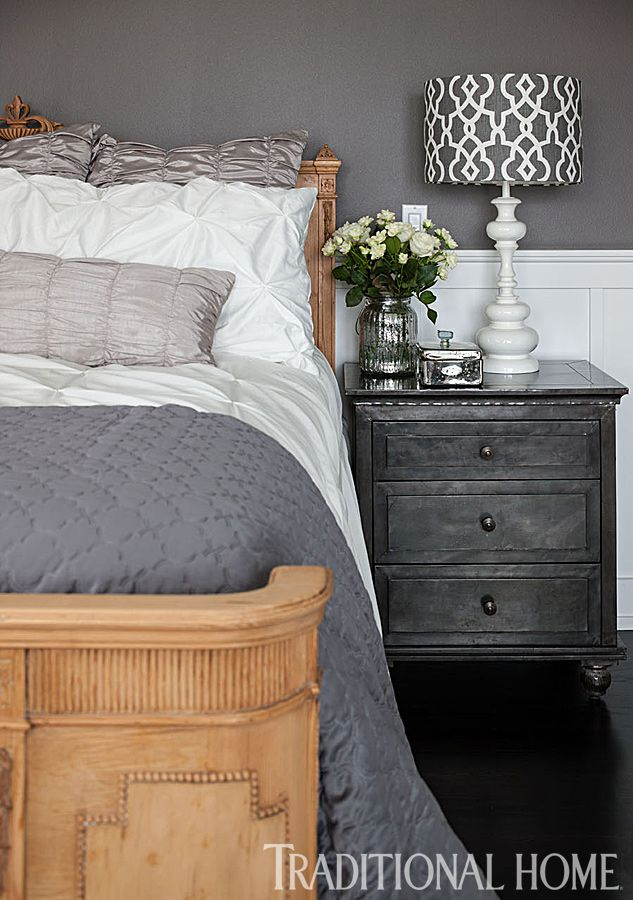 A gorgeous bed and a mix of gray bedding make up this stylish bedroom. - Photo: John Granen / Design: Kristi Spouse