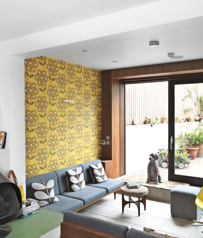Sitting Pretty The ground floor was originally two rooms; now it's been transformed into one continuous space. To compensate for a low ce...