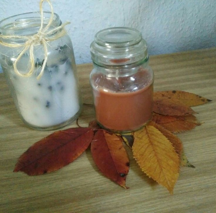 Homemade candles in jar. Autumn style candle.