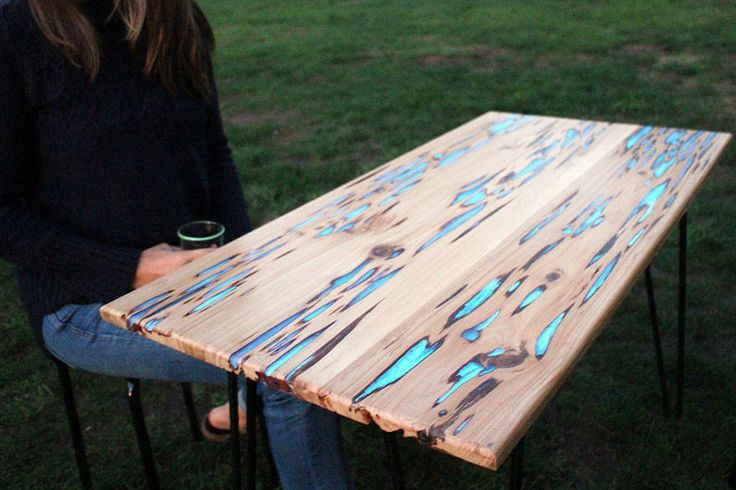 As high-tech and alien as this glow-in-the-dark table might seem, it can actually be made right at home! All you need is a few planks of Pecky cypress wood, photoluminescent powder, resin, some tools, and a little elbow grease.