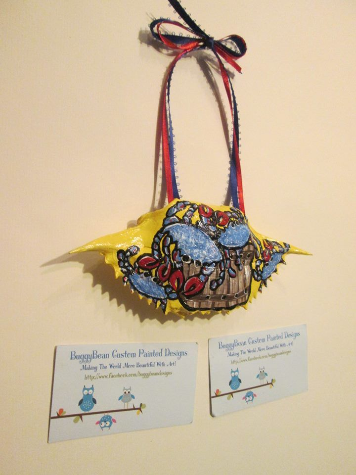 """A crab shell with a """"Bushel Of Crabs"""" hand painted on it! With red and blue…"""