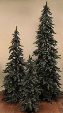"Downswept Alpines have a classic ""Christmas tree"" silhouette, perfect for holiday decor! Long, tapered branches with dense dusty green needles that sweep the floor, on a textured wood trunk and sturdy metal base. 5 feet tall, good for displays, offices or smaller apartments."