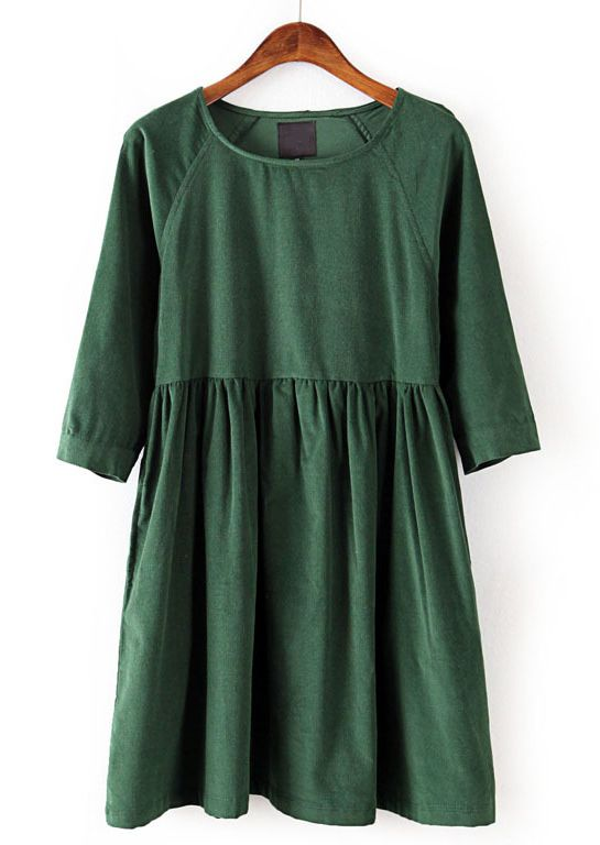 Green loose-fitting dress w/ 3/4 sleeves & gathered skirt