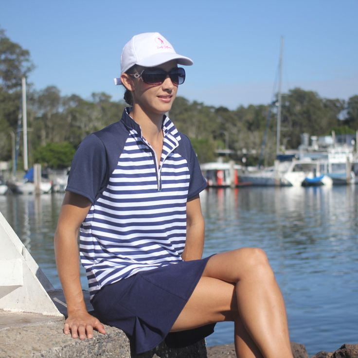 (http://www.ladygolfwear.com.au/ladies-golf-outfit-striped-navy-top-with-navy-skort/)