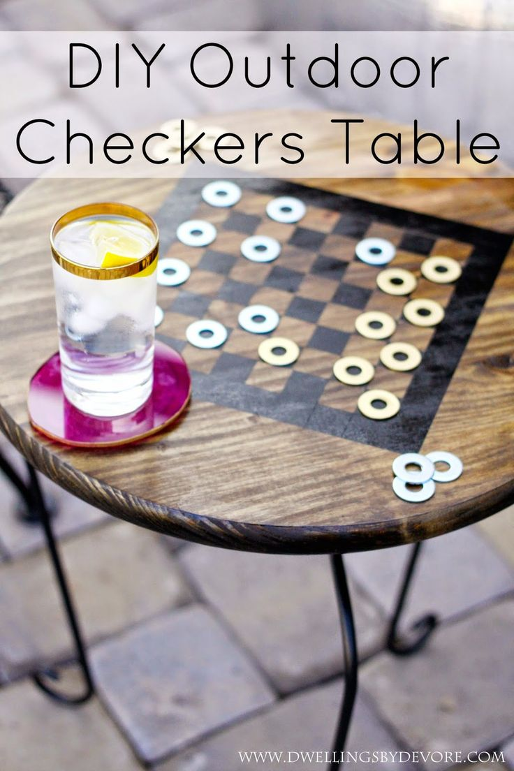Dwellings By DeVore: DIY outdoor checkers table, made from a plant stand and simple wood disc from Home Depot.