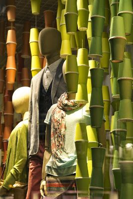 www.retailstorewindows.com #windowdisplay The colorful cups resemble spools of thread to me. Love it. #judithm
