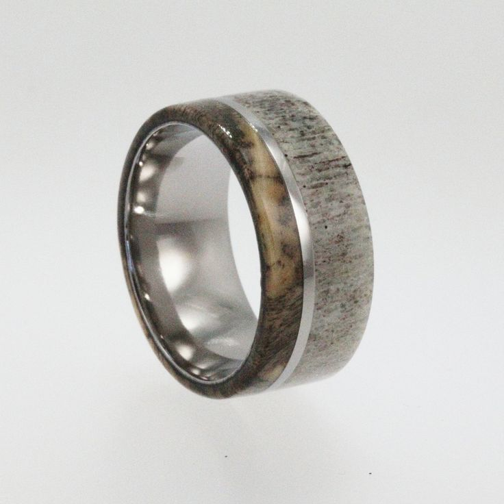 Mens Wedding Band / Titanium ring inlaid with Buckeye Burl Wood and Deer Antler. $299.00, via Etsy.