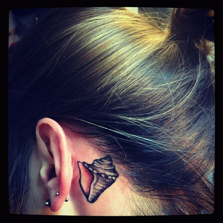 Conch shell tattoo. Love it, so I can always hear the ocean <3
