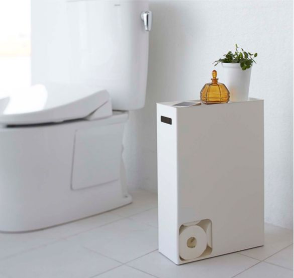 This elegant and compact toilet paper stocker stores up to 12 rolls, and doubles as a stand for placing small objects or phones on top. Design by Yamazaki.