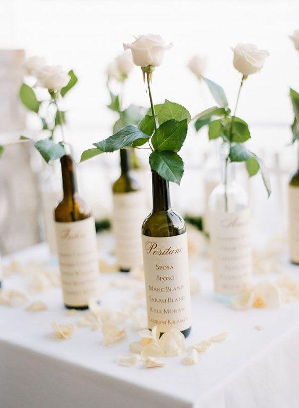tableau de mariage con bottiglie di vino