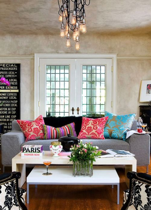 Change up the pillows to Navy & drop the pink & purples. Love the greens & teals with the Grey though! Sleek