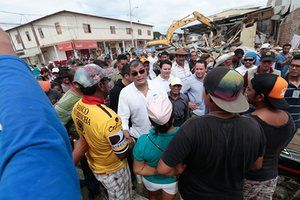 Ecuador's president, Rafael Correa, talks to residents of Jama in the coastal province of Manabi
