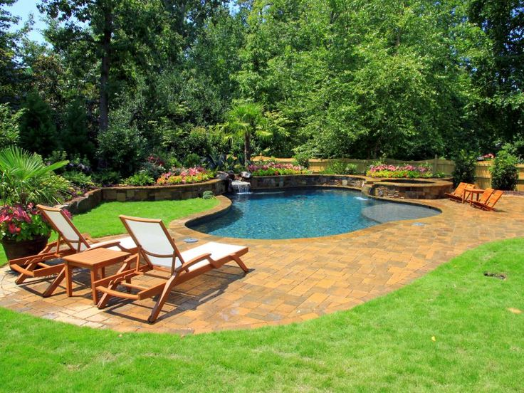 This Casual Yet Elegant Pool Area Features Brick Pavers And Bright White  Lounge Chairs. The
