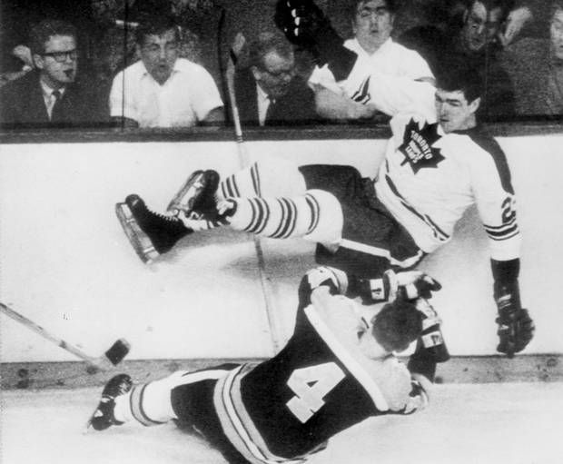Boston Bruin's Bobby Orr goes to the ice after collision with Pat Quinn of the Toronto Maple Leafs in the second period of their National Hockey League playoff game at Boston Garden on April 2, 1969. (Associated Press)