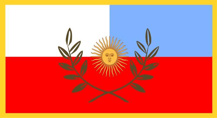 """La bandera de Catamarca fue creada en 2011 y es la más nueva de todas las banderas provinciales. El color rojo representa """"la riqueza cultural de la provincia"""", el celeste y blanco representan los colores de la Vírgen de Luján (patrona de Argentina, Paraguay y Uruguay). El sol del centro es el Sol de los Incas, que habitaron esas tierras, está rodeado de laureles con 16 hojas, las cuales representan a los departamentos de la provincia."""