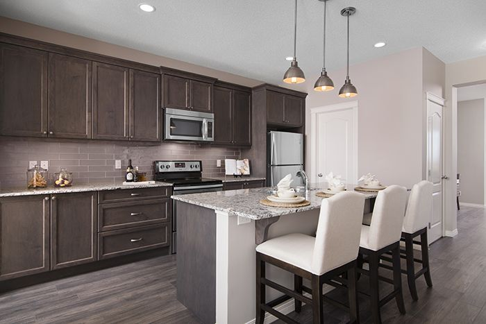Kitchen  in the Wysteria showhome in the community of Redstone in northeast Calgary