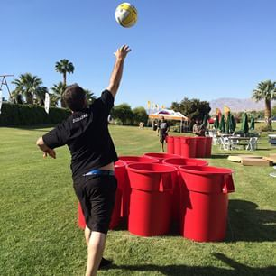 Giant Beer Pong | Traditional beer pong, only with trash cans (or buckets) replacing the cups and volley balls (or cheap rubber balls from the toy section of Walmart or Target) replacing the ping pong balls.