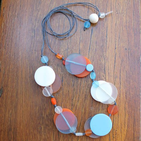 Beach Blue & Orange Jelly Dot Resin Necklace, hand knotted on strong cotton cord.  Double layers of eye popping jelly and and solid resin dots in a beachy fresh assortment of colours and sizes.  Fully adjustable, wear it any length you like.