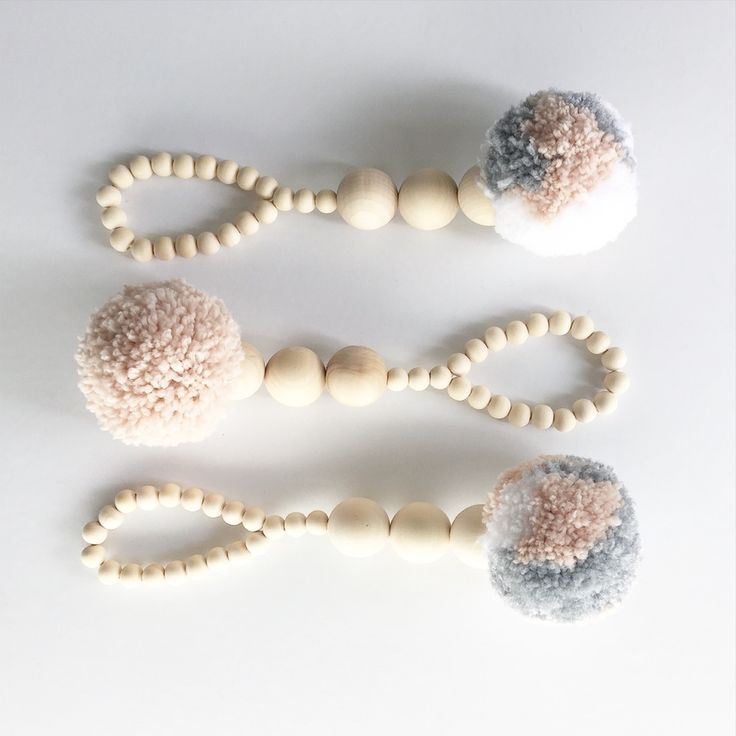 This Scandi inspired super large luxe beaded pom pom hanger is the perfect accessory for your home or little ones space. It is an affordable, on trend item that can be moved around the house and styled so many ways.It is made from yarn, blonde wooden beads and bakers twine and looks fabulous hanging from a wall hook.This listing shows the white but there are lots of colours available. It is also available in grey, pale pink, and black. I have lots of other colours available howe...