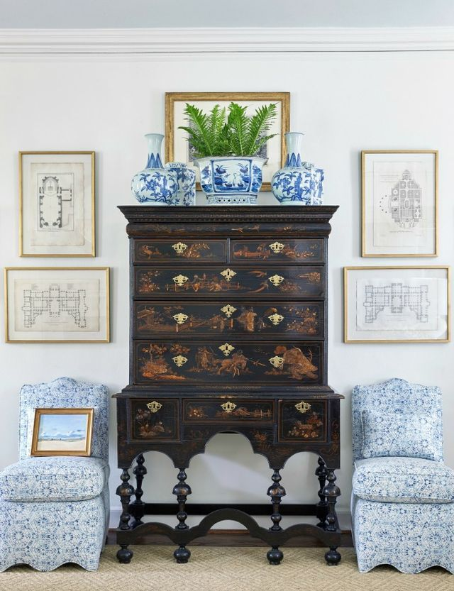 Sarah Bartholomew A lovely vignette with a pair of blue and white scalloped slipper chairs, antique Chinoiserie cabinet, and a collection of blue and white Chinese porcelain. I love the combination of
