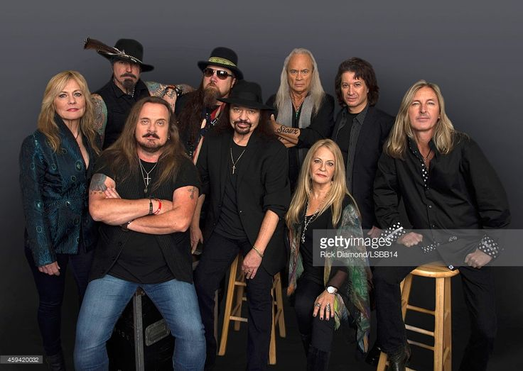 ~This image has been retouched.) Carol Chase, Johnny Colt, Johnny Van Zant, Peter Keys, Gary Rossington, Rickey Medlocke, Dale Rossington, Michael Cartellone, and Mark 'Sparky' Matejka of Lynyrd Skynyrd pose backstage at One More For The Fans! - Celebrating the Songs & Music of Lynyrd Skynyrd at The Fox Theatre on November 12, 2014 in Atlanta, Georgia.