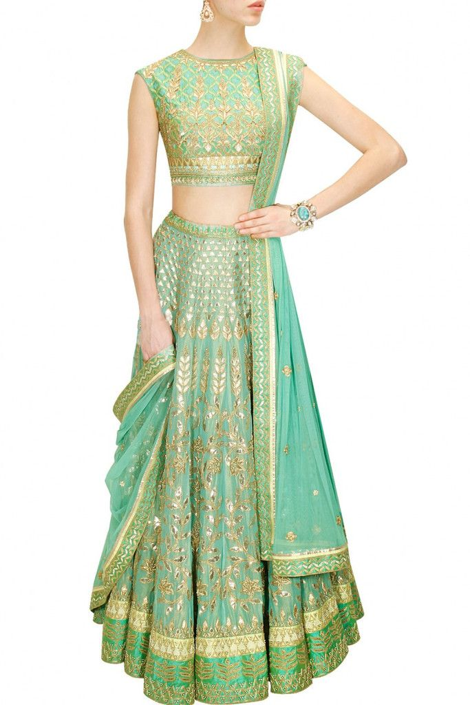 This Aqua color Bridal Lehenga Choli is featuring in georgette fabric embellished with traditional gota patti embroidery. This Aqua color Bridal Lehenga Choli is paired with seafoam round neck embroid