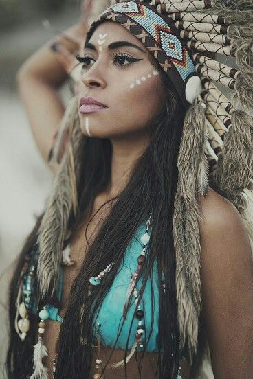 "Many American's will dress as an ""Indian"" for Halloween, similar to the picture shown here. The costume usually entails face paint, buckskin dresses, and a feathered headdress. All of these pieces are very stereotypical and doesn't necessarily represent Native American dress effectively.  This type of dress is similar to those seen in movies and on television."
