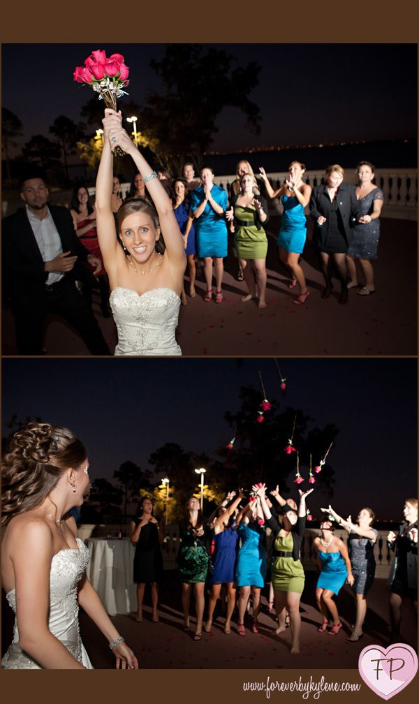 The bouquet toss: a bunch of single roses loosely tied together that will then separate when tossed - everyone gets a chance! Love this!
