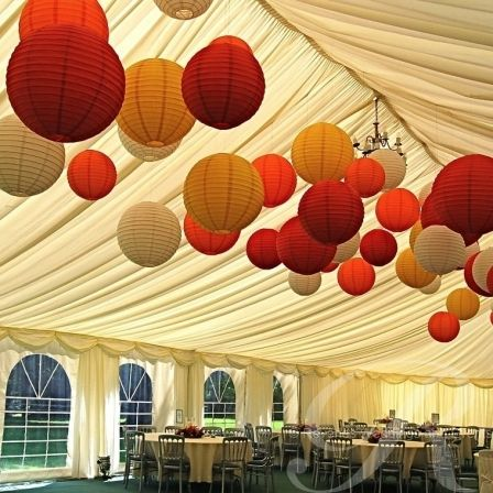 Rich, warm coloured paper lanterns brighten up any autumnal or winter wedding marquee