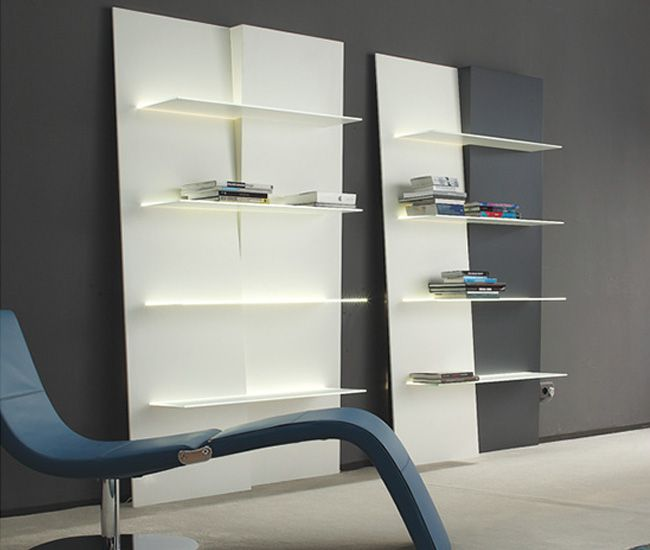 up and down is a wallmounted bookcase featuring an original graphic design that emphasises its depth the frame is made up of two modules