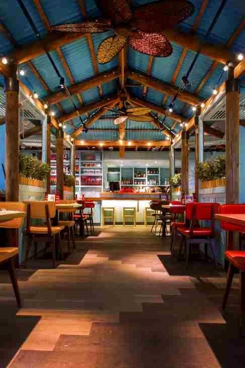Levi Roots Caribbean Smokehouse Interior Caribbean Kitchen In 2019