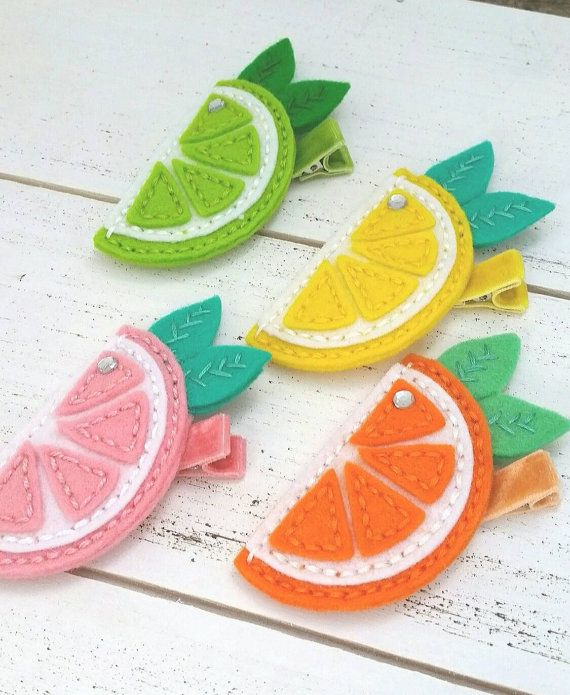 Yummy Lemon Citrus Slice Hair Clip!!!  100 % soft merino wool felt.  Sea green, white, and lemon yellow.  Velvet Partially lined alligator clip.  Non slip grip.  Available with large snap clip.  Cute + Unique Handcrafted Felt Hair Accessories!!!  Berry Cool Designs