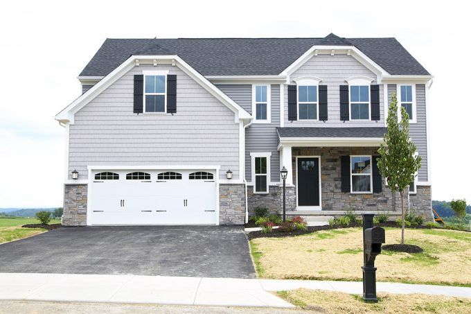 Love this gorgeous home! It's new construction, a Ryan Homes Palermo, and I can't wait to see how she decorates it. Click through to the post to see the full tour!