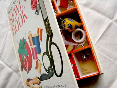 To learn how to make a sewing supplies storage box from an old book (choose a sewing book for maximum awesomeness), download the PDF instructions. The file is 1.3 MB, so be patient if it takes a minute. Go make yourself a sandwich and come back.