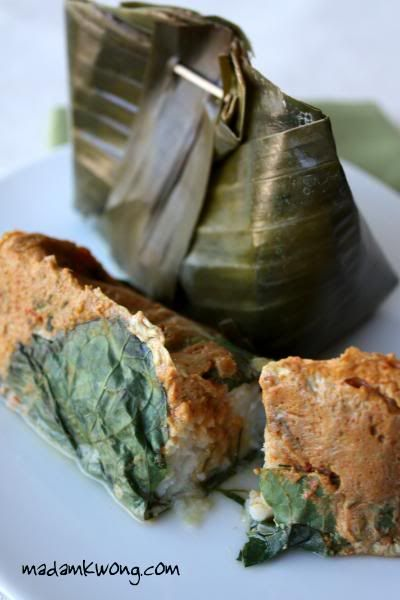 Otah-otah...a fish custard wrapped with banana leaves, ideally grill it above hot charcoal to cook it. Some prefer to steam it above hot water though. Either way should be good, got to try this recipes.