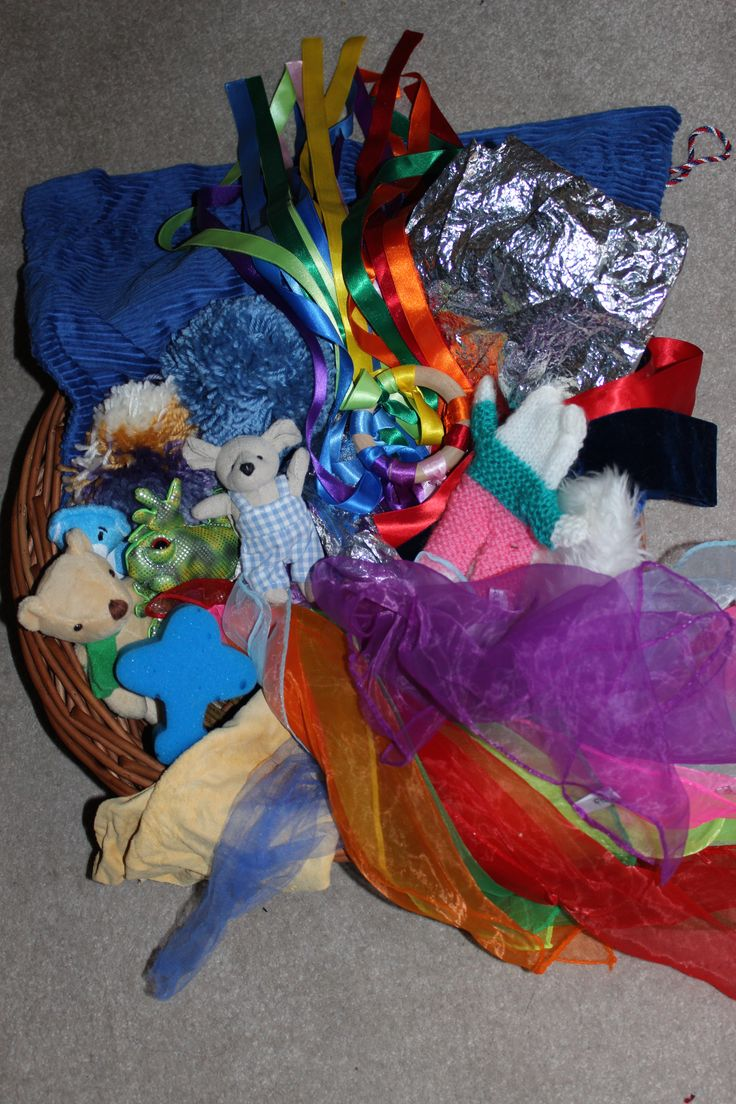 Textile Treasure Basket Ideas from mudpiefridays.com  Heuristic play for toddlers and preschoolers.