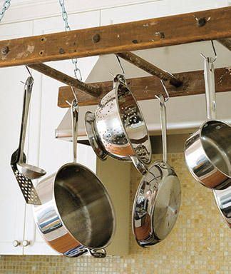 Repurpose a rustic ladder into a kitchen pot rack.