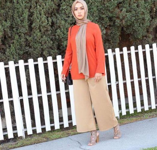 orange blouse with tan pant