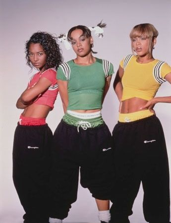 TLC may have had more of a pop sound, but they dressed as if they had a lot of Hip Hop influence. Their crop tops and baggy pants were huge 90s staple pieces.