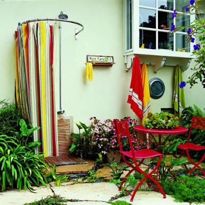 Outdoor California Shower - These homeowners used standard indoor plumbing fixtures and had a stainless steel fabricator build the curved curtain rod. The curtain is made of weatherproof fabric from Sunbrella.