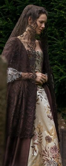 "Very pretty close up shot of Claire's dress. Claire Fraser (Caitriona Balfe) in Episode 207 ""Faith"" of Outlander Season Two on Starz"