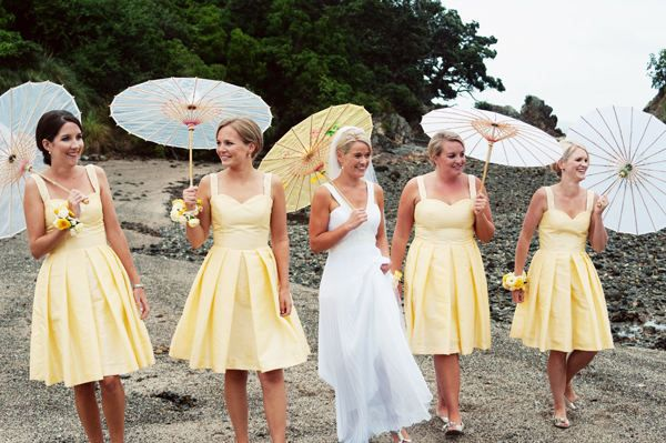 Look how the bridesmaids have white, and the bride has the same yellow as the bridesmaid dresses