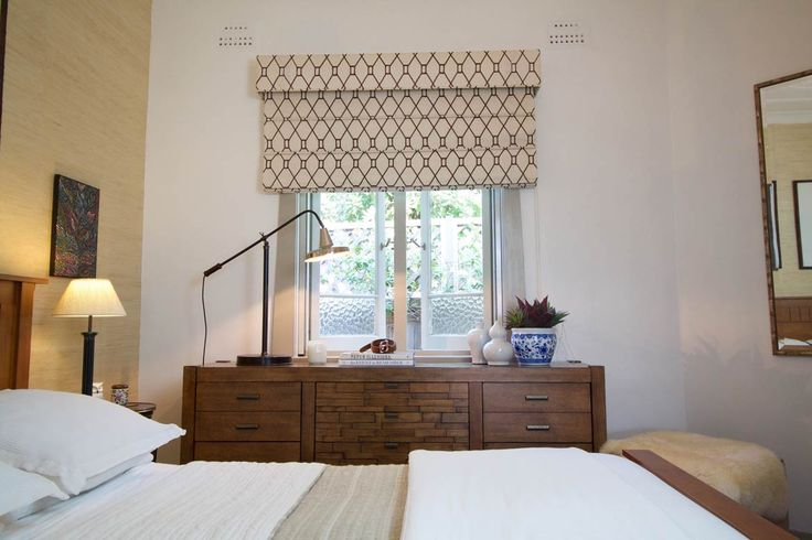 Roman blinds with pelmets using an embroidered linen fabric.