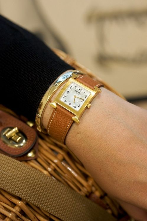 A smashing Hermes watch in matte gold with a lightly pebbled tan leather strap.