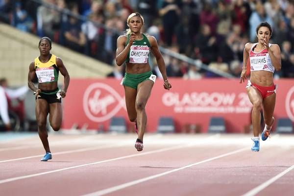 Day 8 action @ Glasgow CWG 2014 Nigeria's Blessing Okagbare (C) powers to victory ahead of silver medalist England's Jodie Williams (R) in the final of the women's 200m athletics event at Hampden Park on July 31, 2014.