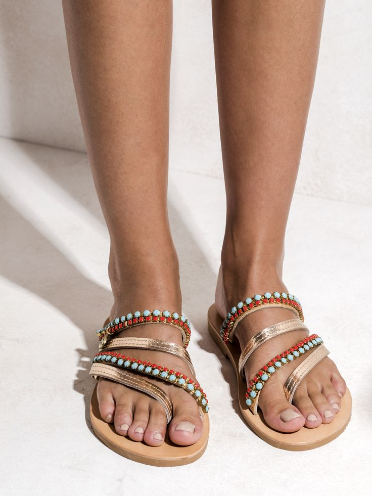 Handmade leather sandals embellished with coral and turquoise Swarovski crystals. The classic pink gold meets the playful turquoise and coral. http://www.elinalinardaki.com/shoes/sandals/all-time-classics/sandal-madagascar/