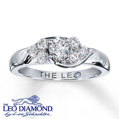 This amazing engagement ring for her features as its dramatic centerpiece a round Leo Diamond that has been laser-inscribed with a unique Gemscribe® serial number. Additional round Leo Diamonds are set in 14K white gold adding sparkle and brilliance. The total diamond weight is 5/8 carat. This fine jewelry ring features independently certified diamonds.