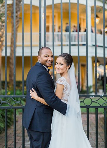 Planning a destination wedding in Charleston, South Carolina is easier than you think with the help of the PPHG event experts | PPHG couple Laura and James outside of The William Aiken House nestled in the heart of downtown Charleston on King Street | Photo by Catherine Ann